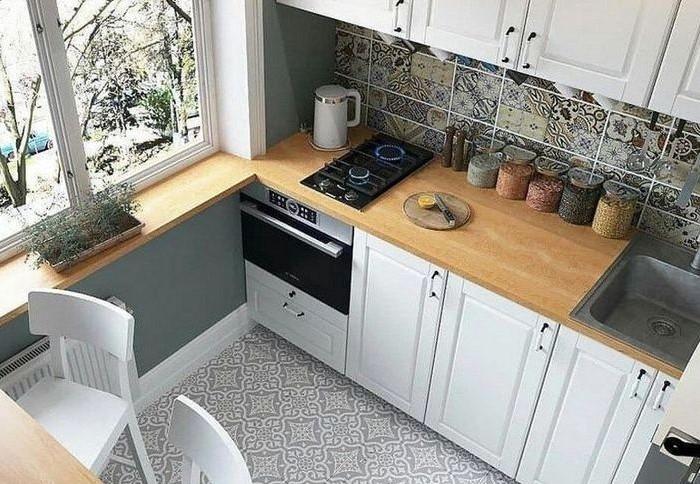 Hа небольшой кухне выделите максимально допустимый отрезок столешницы между мойкой и плитой / Фото: i.pinimg.com