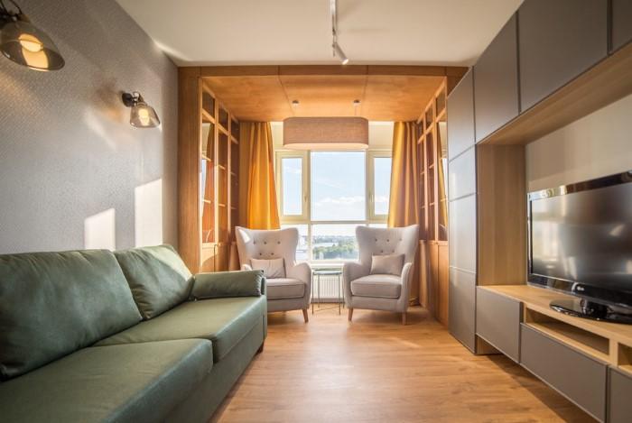 Комната разделена на зоны, которые гармонично сочетаются / Фото: design-homes.ru