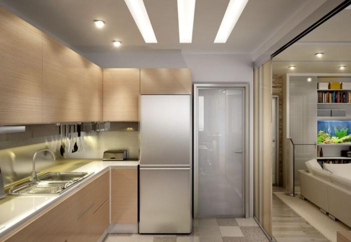 Вместо люстры используйте встраиваемые в потолок светильники и дополнительные источники освещения / Фото: vashestroitelstvo.ru