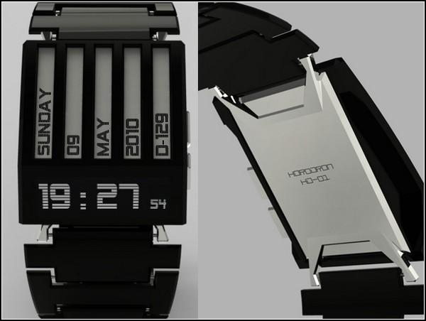 Корпус часов сделаны из блестящего металла темного цвета с малеханькими блестящими вставками.