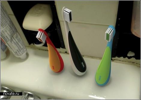 Зубная щетка-неваляшка