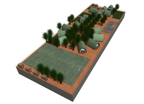 Модель деревни с корпусами школы, кухни, больницы.